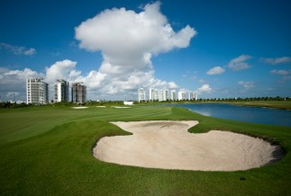 Sand trap overlooking Cancun's Hotel Zone at Puerto Cancun golf course